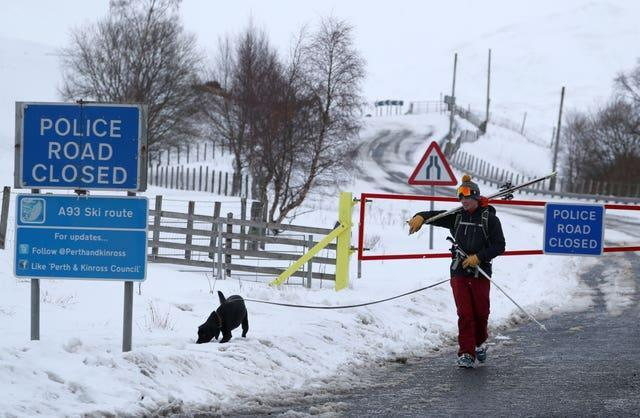 Dog-walking along the A93 near the closed snow gates at the Spittal of Glenshee