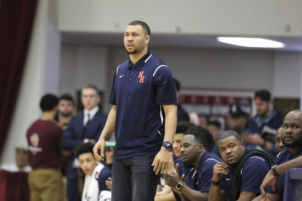 Brandon Roy patrols the Nathan Hale sidelines at the Hoophall Classic. (AP)