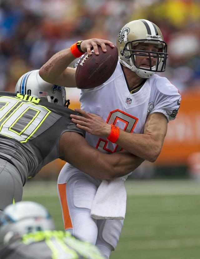 New Orleans Saints quarterback Drew Brees (9), of Team Rice, is sacked by Detroit Lions defensive tackle Ndamukong Suh (90), of Team Sanders, during the first quarter at the NFL Pro Bowl football game at Aloha Stadium, Sunday. Jan. 26, 2014, in Honolulu. (AP Photo/Marco Garcia)