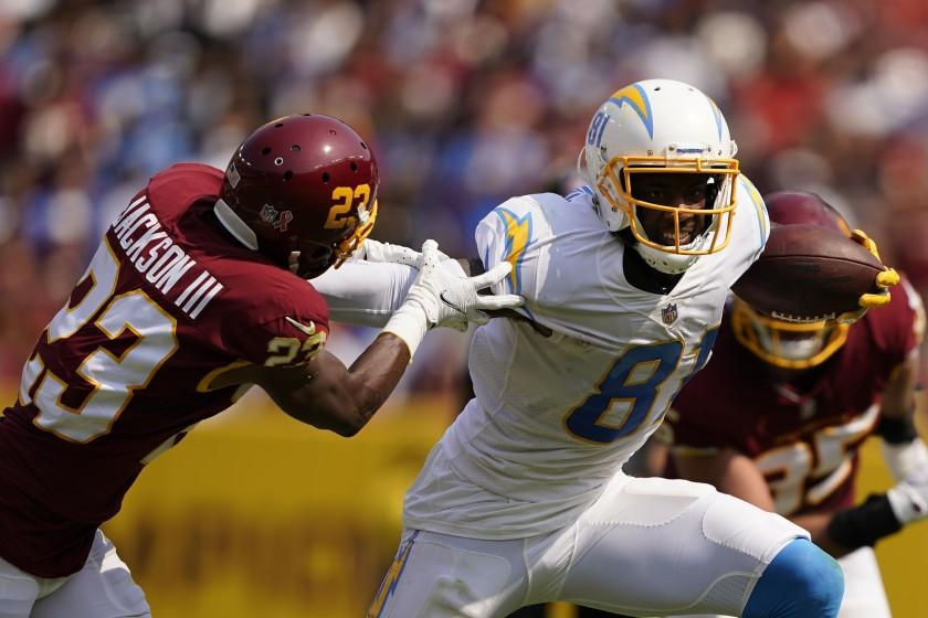 Los Angeles Chargers wide receiver Mike Williams (81) breaks away from Washington Football Team cornerback William Jackson (23) during the first half of an NFL football game, Sunday, Sept. 12, 2021, in Landover, Md. (AP Photo/Andrew Harnik)