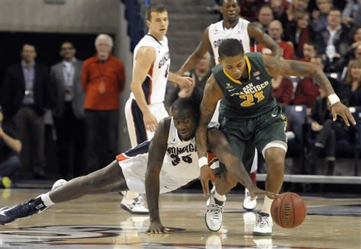 San Francisco's De'End Parker (21) struggles with Gonzaga's Sam Dower (35) as Gonzaga's Kevin Pangos, left rear, and Gary Bell Jr. watch during the first half of an NCAA college basketball game, Saturday, Jan. 26, 2013, in Spokane, Wash. (AP Photo/Jed Conklin)