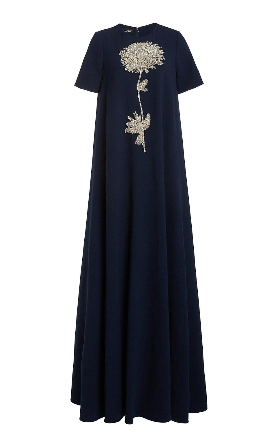 """<p><strong>Oscar de la Renta</strong></p><p>modaoperandi.com</p><p><strong>$4990.00</strong></p><p><a href=""""https://go.redirectingat.com?id=74968X1596630&url=https%3A%2F%2Fwww.modaoperandi.com%2Fwomen%2Fp%2Foscar-de-la-renta%2Ffloral-embroidered-wool-blend-gown%2F479535&sref=https%3A%2F%2Fwww.harpersbazaar.com%2Fwedding%2Fbridal-fashion%2Fg36750122%2Fbest-mother-of-the-groom-dresses%2F"""" rel=""""nofollow noopener"""" target=""""_blank"""" data-ylk=""""slk:SHOP NOW"""" class=""""link rapid-noclick-resp"""">SHOP NOW</a></p><p>A singular, statement embellishment is undoubtedly more impactful and graphic when set on a deep, rich hue rather than a lighter tone. </p>"""