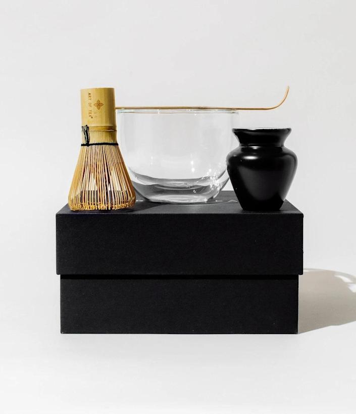 """Not in a rush? Interested in taking an elegant scenic route? Order Art of Tea's <a href=""""https://www.artoftea.com/products/at-home-matcha-kit"""" rel=""""nofollow noopener"""" target=""""_blank"""" data-ylk=""""slk:At Home Matcha Kit"""" class=""""link rapid-noclick-resp"""">At Home Matcha Kit</a>. It's a stunning set complete with a handblown glass bowl, a signature bamboo matcha whisk, a matching bamboo measuring spoon, and a chic matte black whisk holder. You'll enjoy this contemporary spin on the traditional matcha ceremony. $55, Art of Tea. <a href=""""https://www.artoftea.com/products/at-home-matcha-kit"""" rel=""""nofollow noopener"""" target=""""_blank"""" data-ylk=""""slk:Get it now!"""" class=""""link rapid-noclick-resp"""">Get it now!</a>"""