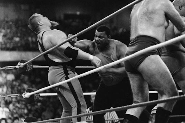 "William Perry, right, fights Jim ""The Anvil"" Neidhart at WrestleMania 2 (AP)"