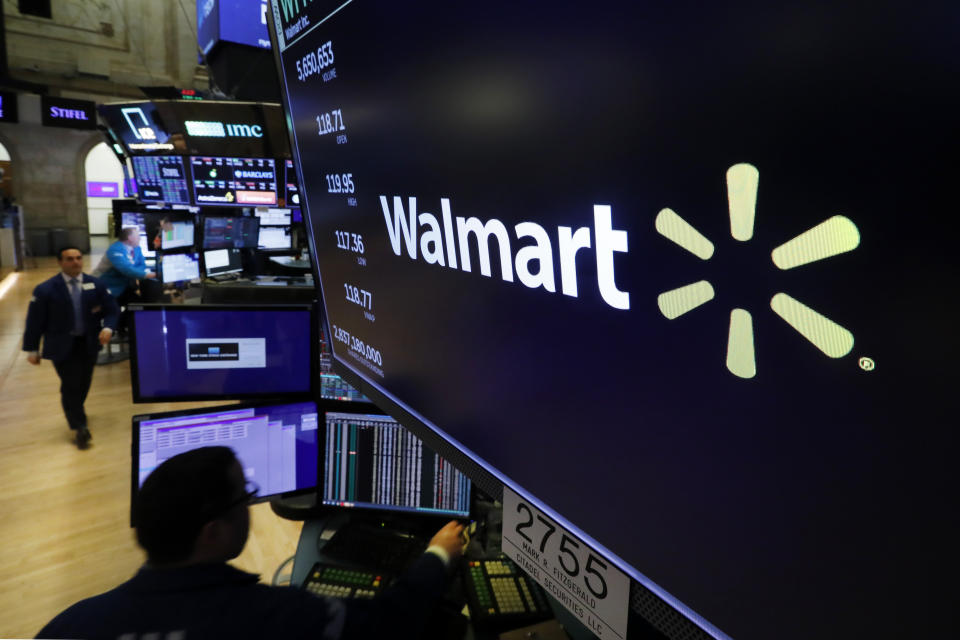 FILE - In this Feb. 18, 2020 file photo, the logo for Walmart appears above a trading post on the floor of the New York. Walmart says it has removed ammunition and firearms from displays at some of its stores. The move comes in the wake of the killing of George Floyd that has set off sometimes violent demonstrations against police brutality and injustice against African Americans. (AP Photo/Richard Drew)