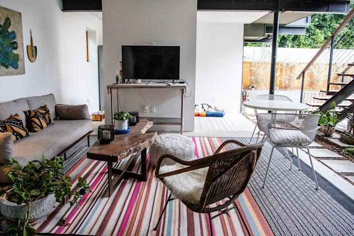 The outdoor area of Gail Otter's ADU includes a TV, sofa and chairs.