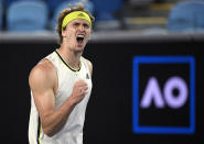 Germany's Alexander Zverev celebrates winnig the second set against Serbia's Dusan Lajovic during their fourth round match at the Australian Open tennis championships in Melbourne, Australia, Sunday, Feb. 14, 2021. (AP Photo/Andy Brownbill)