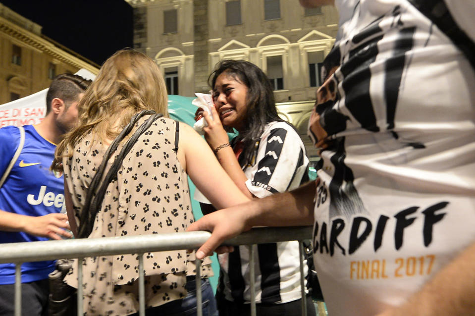 <p>An injured woman cries at Piazza San Carlo after a panic movement in the fanzone where thousands of Juventus fans were watching the UEFA Champions League Final football match between Juventus and Real Madrid on a giant screen, on June 3, 2017 in Turin. (Massimo Pinca/AFP/Getty Images) </p>