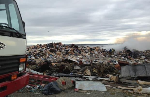 A fire at the Rankin Inlet dump in 2014. Many communities rely on burning to reduce garbage, but Mayor Harry Towtongie says the landfill is too close to town to have open fires.