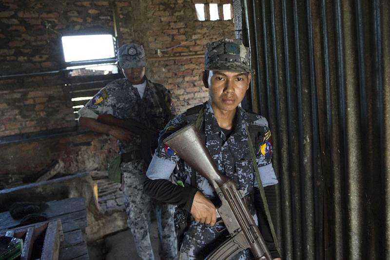 Myanmar border police check a building during a patrol in Maungni village, Rakhine state