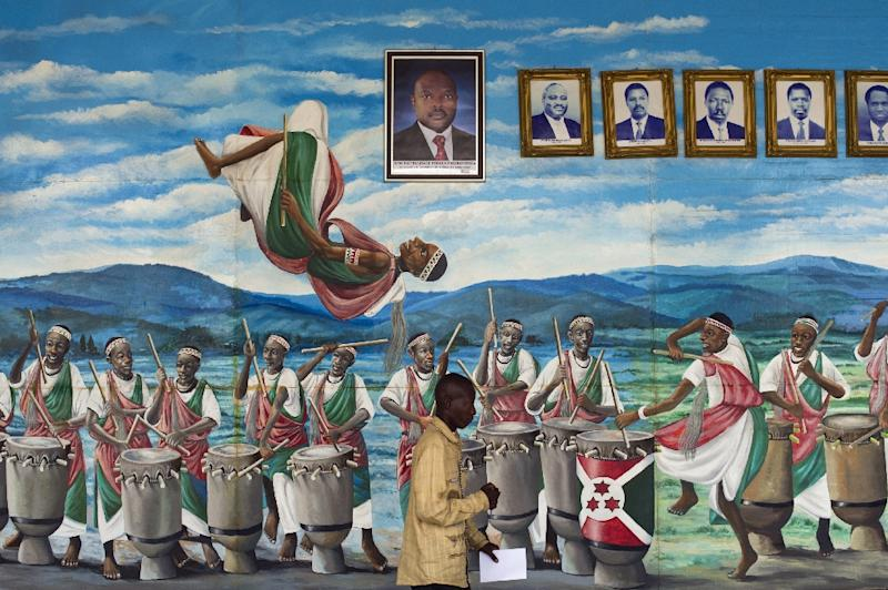 A mural in Bujumbura's National Assembly shows drummers and dancers along with portraits of Burundi's former and current presidents (AFP Photo/Phil Moore)