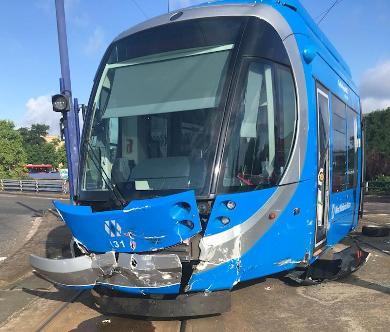 The tram sustained substantial damage and was derailed following the collision. (SWNS)