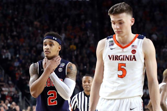 Auburn's Bryce Brown (L) gestures as Virginia's Kyle Guy looks on in the second half during the 2019 NCAA Final Four semifinal at U.S. Bank Stadium on April 6, 2019 in Minneapolis, Minnesota. (Getty)