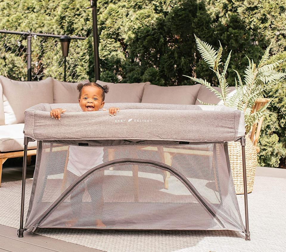 """It'llgive your child a safe and secure place to snooze and play when you've got a million other things to do.<br /><br /><strong>Promising review:</strong>""""This travel crib exceeded my expectations! Folded, its roughly the same size and shape as my Pack and Play,but a little lighter. Unfolded is when it shines, it is slightly narrower and longer than a pack and play, ideal for my long toddler as she grows.<strong>She has to lay diagonal in other mini cribs, but here, she can lay straight with room to spare.</strong>I also love the little zippable 'door' at floor level, it really helps if I want to give her the freedom of getting out on her own. Both my kids were especially delighted with this too, they loved to use it as a 'tent' and play in the open crib. It gave them a special place to feel was theirs in a tight guest room."""" — <a href=""""https://www.amazon.com/gp/customer-reviews/RWXNWLHWQQBCK?&linkCode=ll2&tag=huffpost-bfsyndication-20&linkId=0923880f0e607011bf66fda71ebfe8b7&language=en_US&ref_=as_li_ss_tl"""" target=""""_blank"""" rel=""""noopener noreferrer"""">Jade Klinger</a><br /><br /><strong><a href=""""https://www.amazon.com/dp/B082J86RT2?&linkCode=ll1&tag=huffpost-bfsyndication-20&linkId=e273be22d191adba423432c45efaea25&language=en_US&ref_=as_li_ss_tl"""" target=""""_blank"""" rel=""""noopener noreferrer"""">Get it from Amazon for $119.99.</a></strong>"""