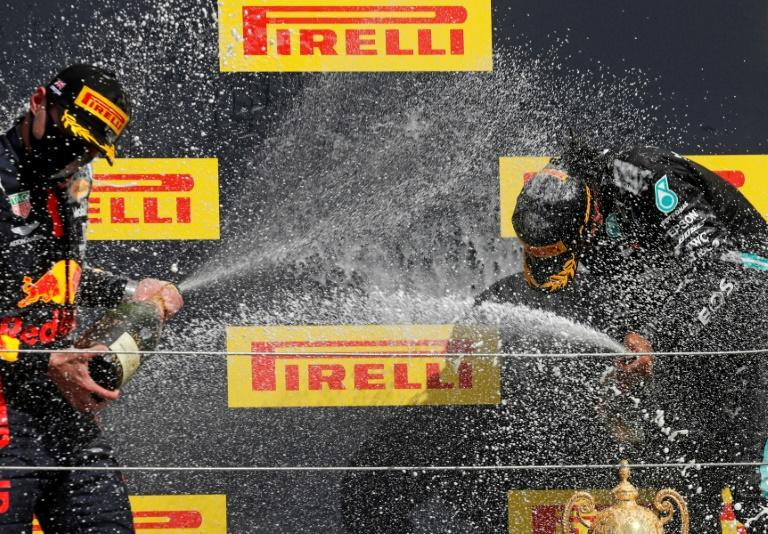 Spray for us: Lewis Hamilton (right) and Max Verstappen on the podium