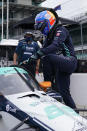 Fernando Alonso, of Spain, climbs into his car during a practice session for the Indianapolis 500 auto race at Indianapolis Motor Speedway, Wednesday, Aug. 12, 2020, in Indianapolis. (AP Photo/Darron Cummings)