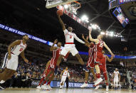 <p>Terence Davis #3 of the Mississippi Rebels drives to the basket against Brady Manek #35 of the Oklahoma Sooners in the first half during the first round of the 2019 NCAA Men's Basketball Tournament at Colonial Life Arena on March 22, 2019 in Columbia, South Carolina. (Photo by Kevin C. Cox/Getty Images) </p>