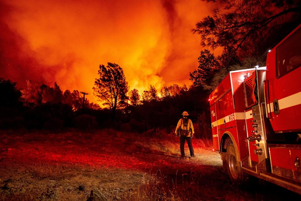 A firefighter watching the approaching blaze in Oroville, California after hundreds of people were evacuated from the area (AFP/Getty)