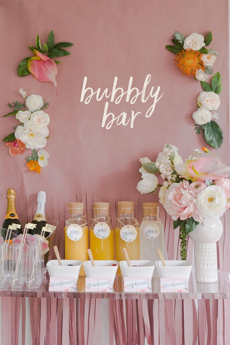 """<p>These labels help ID the juice blends and garnishes and are attached with colorful twine, clothespins, or decorative ribbon. </p><p>Get the tutorial at <a href=""""https://ruffledblog.com/mimosa-bar-bridal-shower-brunch-free-printables/"""" rel=""""nofollow noopener"""" target=""""_blank"""" data-ylk=""""slk:Ruffled"""" class=""""link rapid-noclick-resp"""">Ruffled</a>.</p>"""