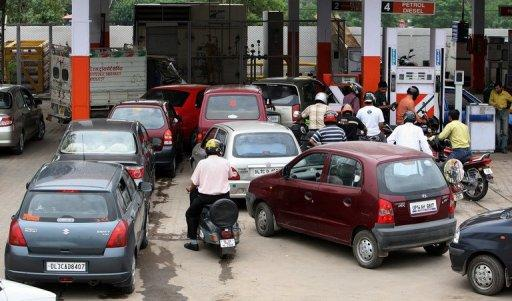 This file photo shows motorists lining up to get petrol and diesel at a filling station in New Delhi, in 2008. India's government is facing a growing backlash after hiking diesel 12 percent in a desperate bid to reverse its economic woes, as opponents say the move would stoke broader price rises