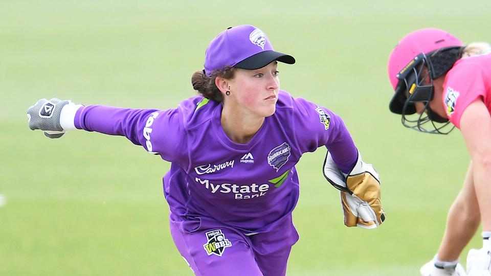 Emily Smith (pictured centre) wicket keeping for the Hurricanes.