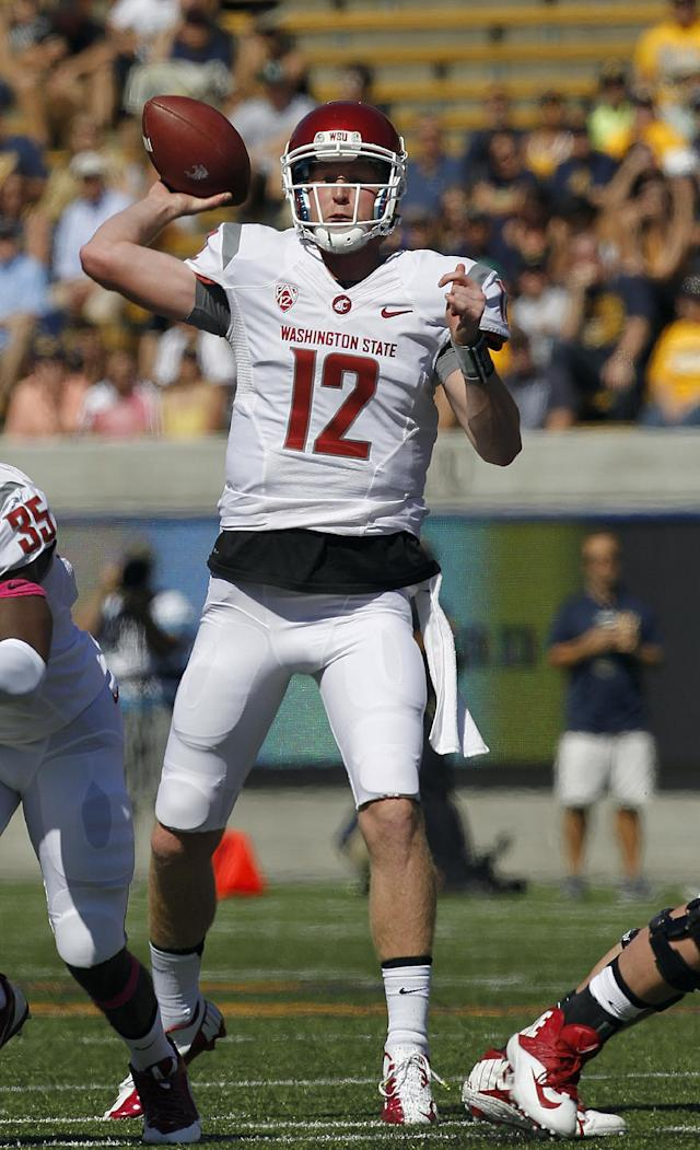 Washington State quarterback Connor Halliday (12) passes against California during the first half of an NCAA college football game in Berkeley, Calif., Saturday, Oct. 5, 2013. (AP Photo/Tony Avelar)