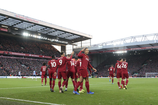 Liverpool's Virgil van Dijk centre right celebrates after scoring his second goal during the English Premier League soccer match between Liverpool and Brighton at Anfield Stadium, Liverpool, England, Saturday, Nov. 30, 2019. (AP Photo/Jon Super)