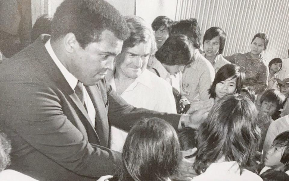 Bashall with Muhammad Ali, who visited the camp in Hong Kong: the refugees were enthralled by the boxer's charisma, he recalled