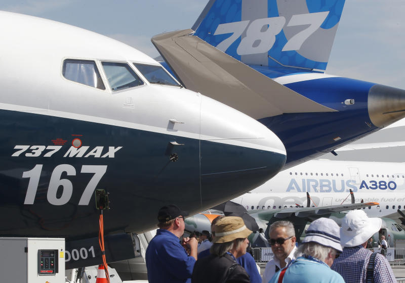 FILE - In this June 20, 2017, file photo Boeing planes displayed at Paris Air Show, in Le Bourget, east of Paris, France. Uncertainty over a Boeing jet and apprehension about the global economy hover over the aircraft industry as it prepares for next week's Paris Air Show. (AP Photo/Michel Euler, File)