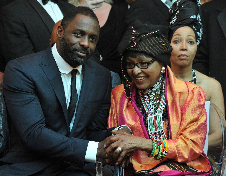 """Nelson Mandela's second wife Winnie Madikizela–Mandela (R) and British actor Idris Elba, who plays the role of Nelson Mandela in the movie """"Mandela, Long Walk to Freedom"""", attend the movie's premiere in Johannesburg on November 3, 2013"""
