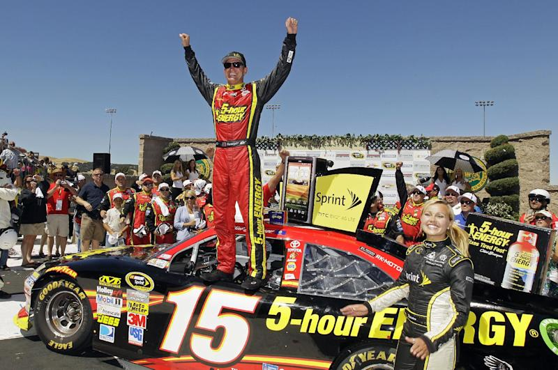 Clint Bowyer celebrates on top of his car after winning the NASCAR Sprint Cup Series auto race, Sunday, June 24, 2012, in Sonoma, Calif. (AP Photo/Eric Risberg)