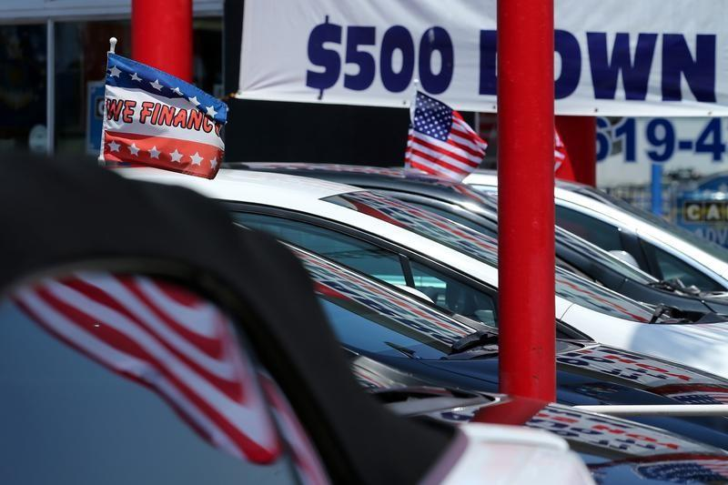 Cars are shown for sale with financing at a car lot in National City, California