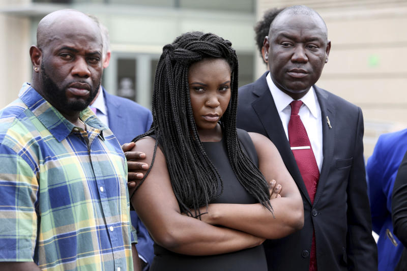"""Michael McGlockton, from left, Britany Jacobs and attorney Benjamin Crump attend a press conference at the Pinellas County Criminal Justice Center Thursday, July 26, 2018, in Clearwater, Fla. Crump, who gained national prominence representing the family of Trayvon Martin after the black teen's fatal shooting by a Hispanic man in 2012, said Michael Drejka committed """"cold-blooded murder"""" in the death of Markeis McGlockton outside a Clearwater convenience store on July 19. (Douglas R. Clifford/Tampa Bay Times via AP)"""