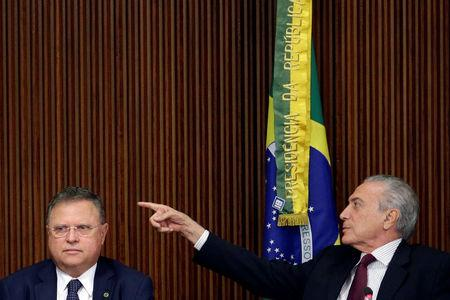 Brazil's President Michel Temer gestures near Brazil's Agriculture Minister Blairo Maggi during a meeting with ambassadors of meat importing countries of Brazil at the Planalto Palace in Brasilia