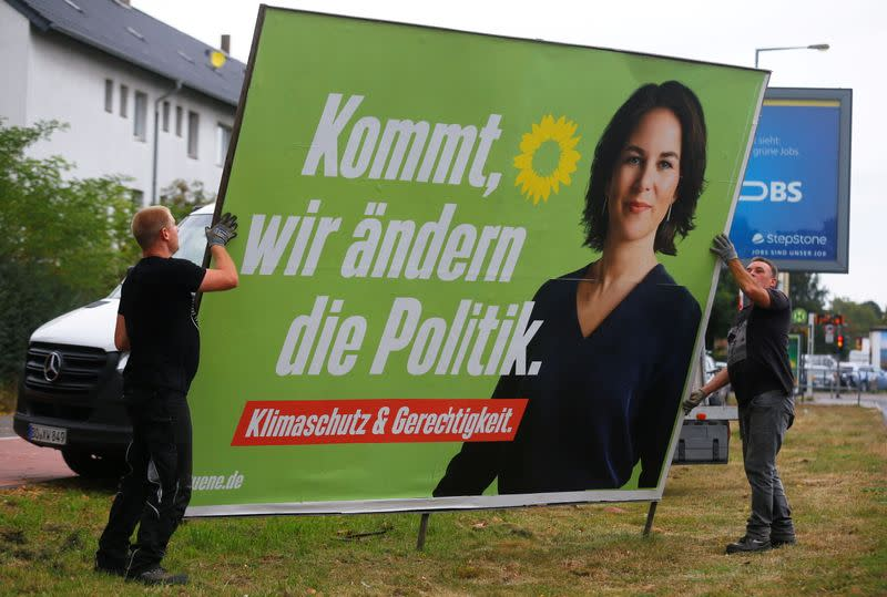 FILE PHOTO: Workers remove election campaign posters after general election in Germany