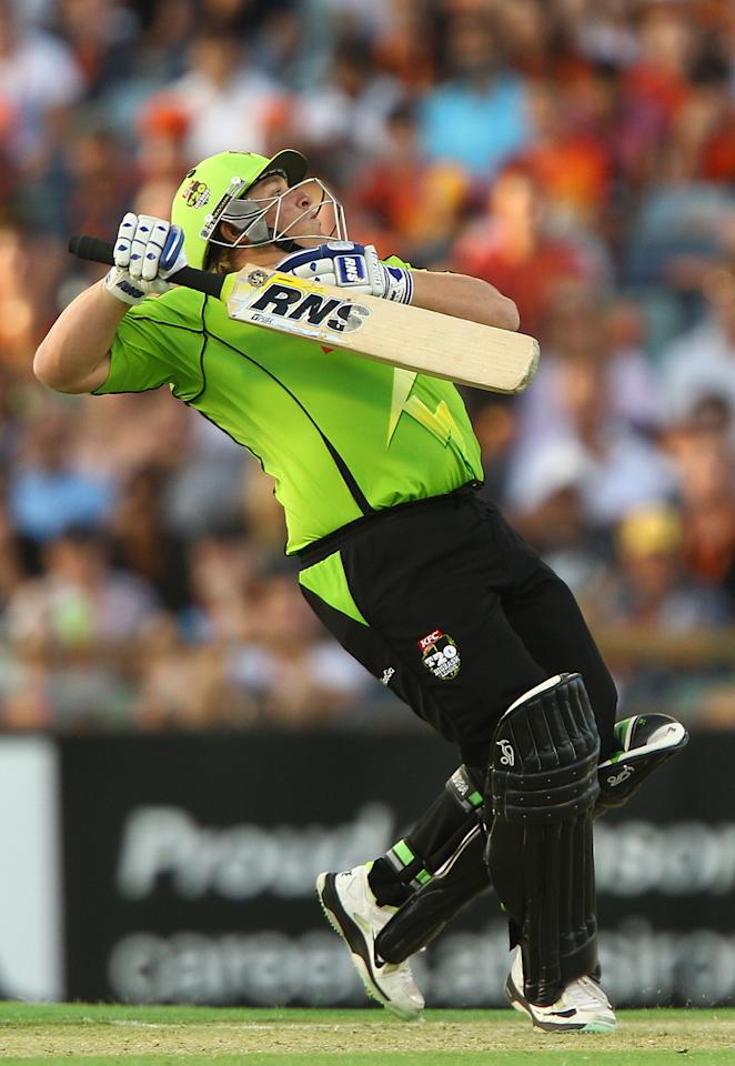 PERTH, AUSTRALIA - JANUARY 04: Mark Cosgrove of the Thunder fends off a high ball from Nathan Coulter-Nile of the Scorchers during the Big Bash League match between the Perth Scorchers and the Sydney Thunder at WACA on January 4, 2013 in Perth, Australia.  (Photo by Paul Kane/Getty Images)