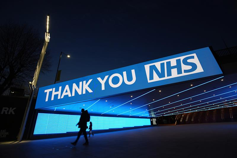 A sign by Wembley Park Tube Station in London that thanks the hardworking NHS staff who are trying to battle coronavirus. A national salute for the frontline healthcare heroes is taking place across the UK with a mass round of applause from doorsteps, windows and balconies on Thursday at 8pm.