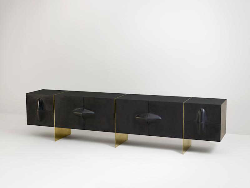 A rubber and brass console by Brian Thoreen.