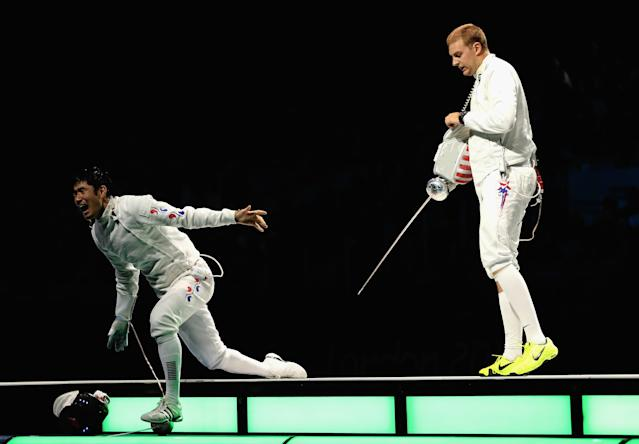 LONDON, ENGLAND - AUGUST 01: (L-R) Jinsun Jung of Korea left celebrates victory in the Men's Epee Individual Fencing Bronze medal match against Seth Kelsey of the United States on Day 5 of the London 2012 Olympic Games at ExCeL on August 1, 2012 in London, England. (Photo by Hannah Johnston/Getty Images)