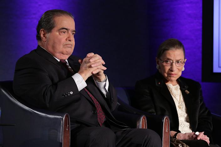 "Supreme Court Justices Antonin Scalia (L) and Ruth Bader Ginsburg (R) wait for the beginning of the taping of ""The Kalb Report"" April 17, 2014 at the National Press Club in Washington, DC. (Alex Wong/Getty Images)"