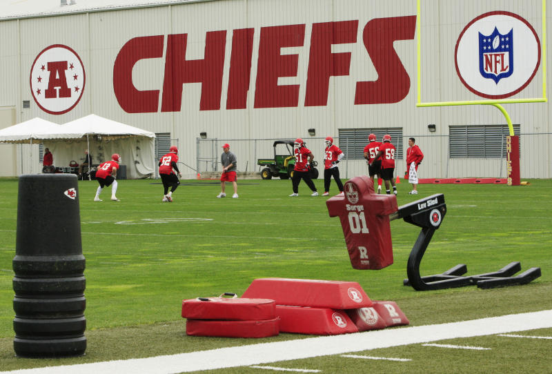 In this Wednesday, May 19, 2010 photo, Kansas City Chiefs football players work out during an NFL football mini camp at the team's practice facility in Kansas City, Mo. Police say a 25-year-old Kansas City Chiefs player was involved in two shootings Saturday, Dec. 1, 2012, one of which occurred in the parking lot near Arrowhead Stadium.  (AP Photo/Orlin Wagner)