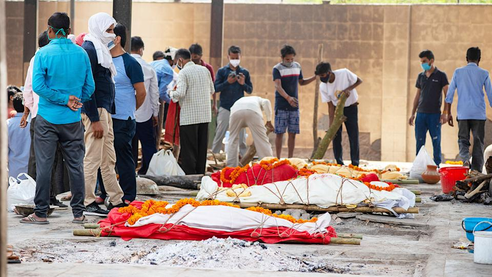 Several funeral pyres of people who died of Covid-19, pictured here during a mass cremation in New Delhi, India.