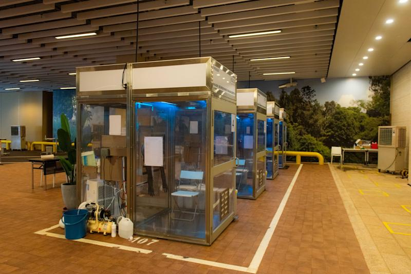 People can get tested at swab booths, or while seated in their vehicles at One Farrer Hotel as part of a drive-through testing initiative. (PHOTO: Temasek Foundation)