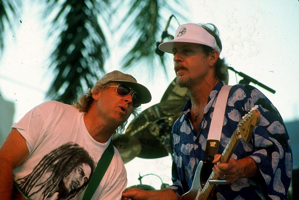 Jimmy Buffett sings with Little Feat's guitarist Paul Berrere during the last set of the group's performance Sunday, May 7, 1995 at SunFest. Buffett surprised fans by appearing on stage with Little Feat and playing several songs for the crowd gathered at the north stage.