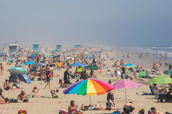 People enjoy the beach amid the pandemic in Huntington Beach, California, on April 25.