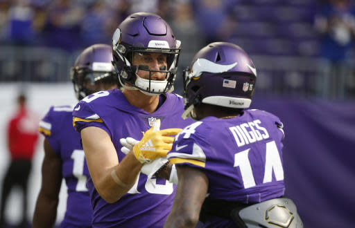 FILE - In this Sept. 23, 2018, file photo, Minnesota Vikings wide receiver Adam Thielen talks with teammate Stefon Diggs, right, before an NFL football game against the Buffalo Bills in Minneapolis. This dominant wide receiver duo is a major reason why the Vikings remain in the mix with the NFC's top contenders despite some rough spots in the first half of the season. (AP Photo/Bruce Kluckhohn, File)