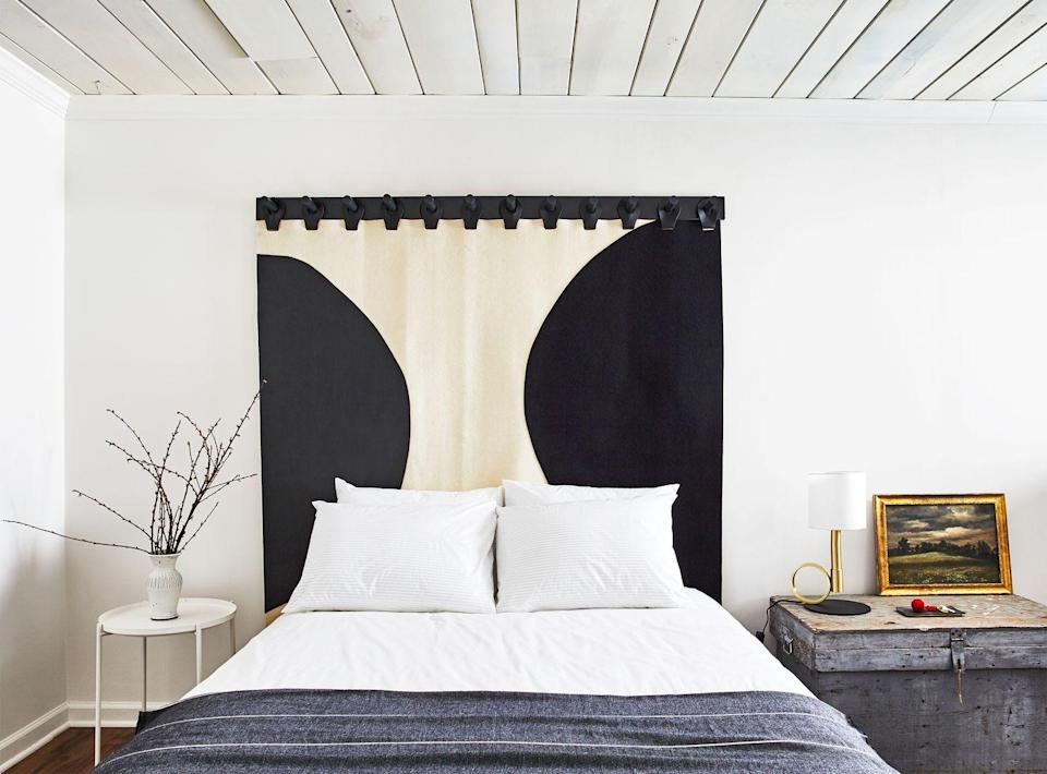 <p>Outfit a neutral bedroom with a trendy curtain-style headboard. Bonus: It's an easy way to experiment with pattern.</p>