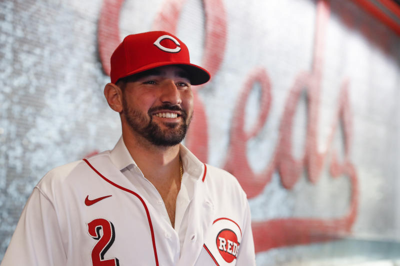 Cincinnati Reds' Nick Castellanos waits for interviews during a news conference, Tuesday, Jan. 28, 2020, in Cincinnati. Castellanos signed a $64 million, four-year deal with the baseball club. (AP Photo/John Minchillo)