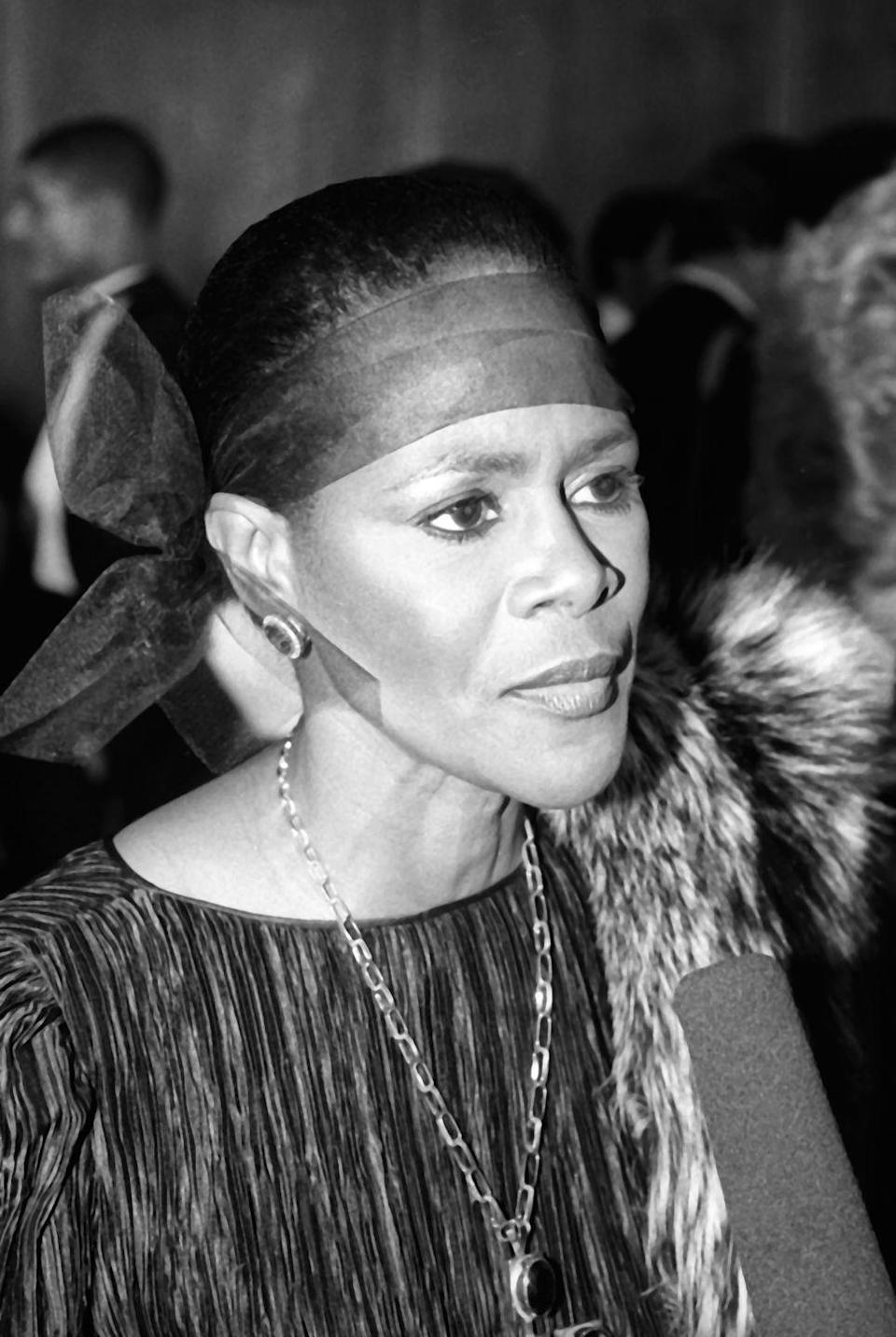 <p>Stunning in statement earrings and necklace, tulle bow, and a fur, Cicely interviews during the Celebration of Life Gala, honoring Dr. Martin Luther King Jr. and his accomplishments in 1989 D.C.</p>