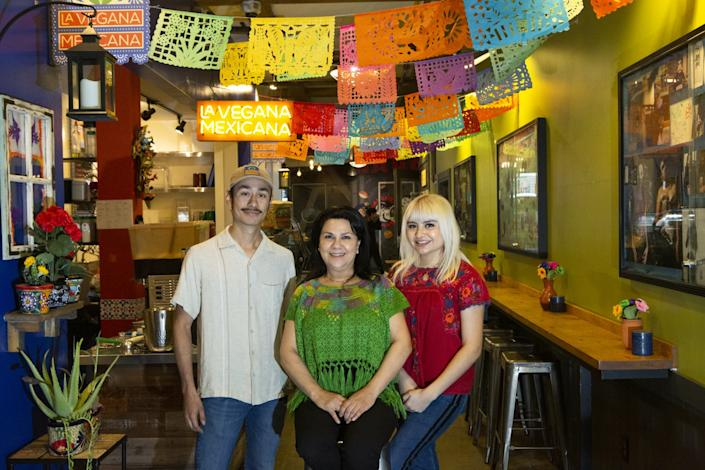 "La Vegana Mexicana's Alejandro Sierra, Loreta Ruiz, center, and Loreta Sierra. The restaurant is in 4th Street Market in Santa Ana. <span class=""copyright"">(Gabriella Angotti-Jones / Los Angeles Times)</span>"